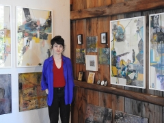 Artist Sinejan Buchina with some of her works at Fisher's Barn. <em>(Photo courtesy GreatWesternCatskills.com)</em>